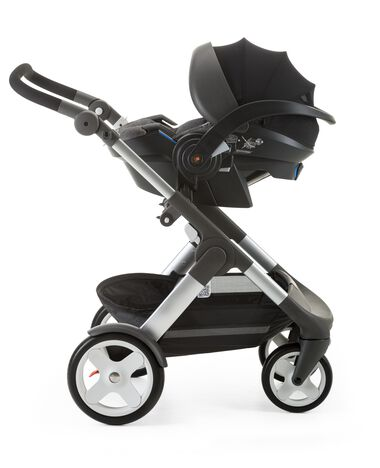 Stokke® iZi Go Modular™ by Besafe®, Black Melange. Mounted on Stokke® Trailz™ with Classic Wheels.