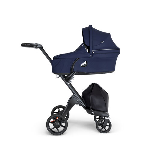 Stokke® Xplory® wtih Black Chassis and Leatherette Black handle. Stokke® Stroller Carry Cot Deep Blue. view 3
