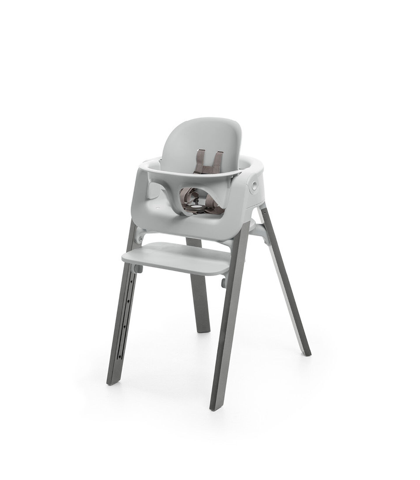 Stokke® Steps™ Storm Grey chair with Baby Set Light Grey.