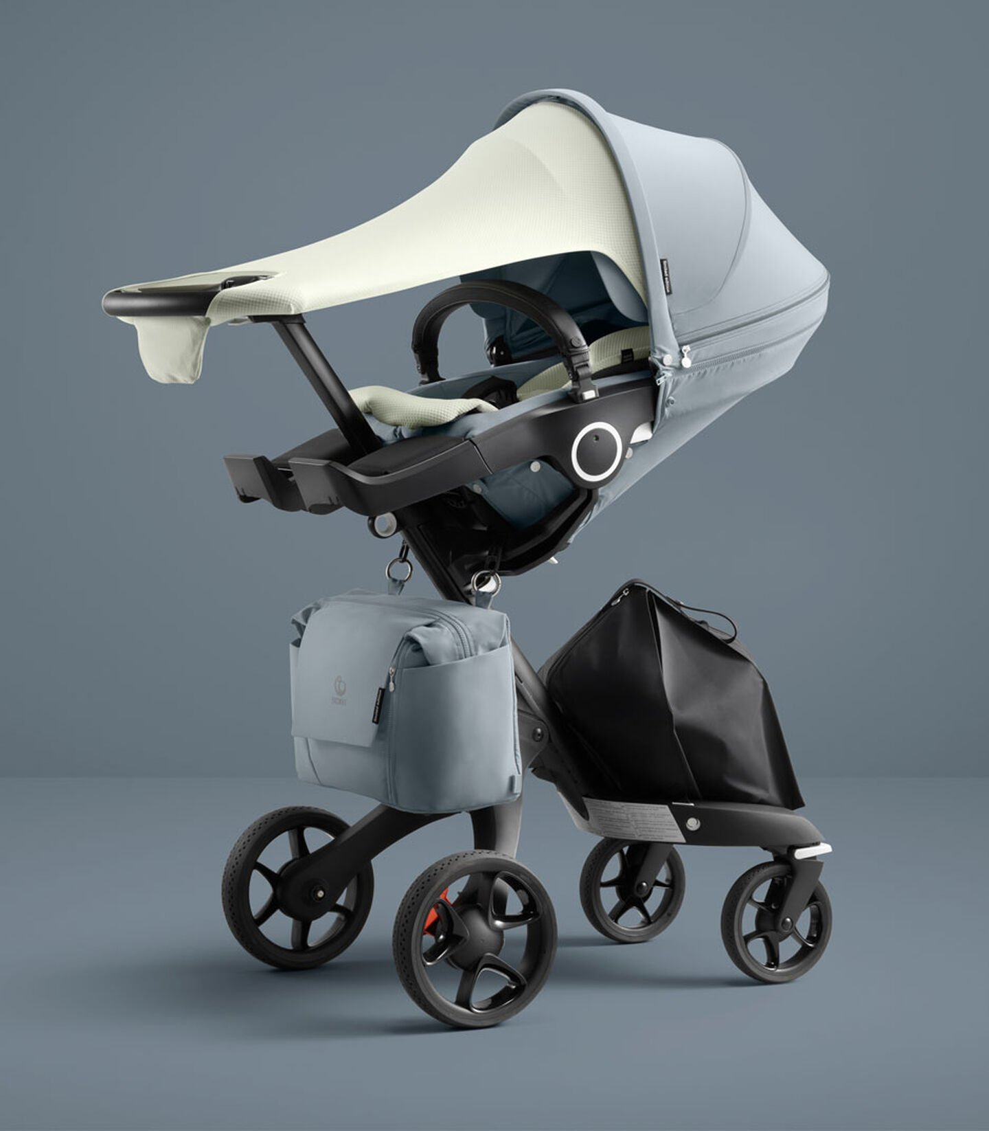 Stokke® Xplory® 6 Balance Limited Edition with Stokke® Stroller Seat. Tranquil Blue. What's included: Seat textile, Seat Inlay, Sun Sail & Changing Bag. view 1