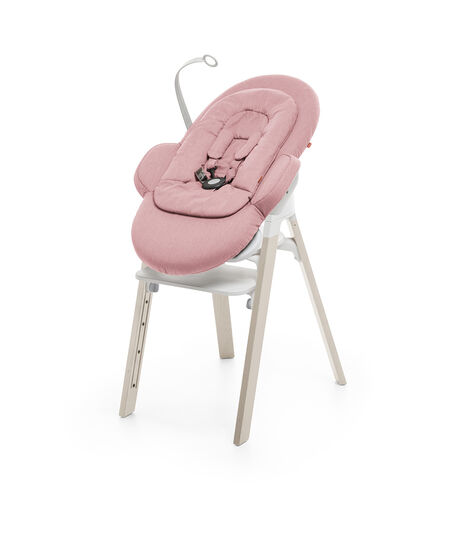 Bouncer, Pink. Mounted on Stokke Steps highchair.