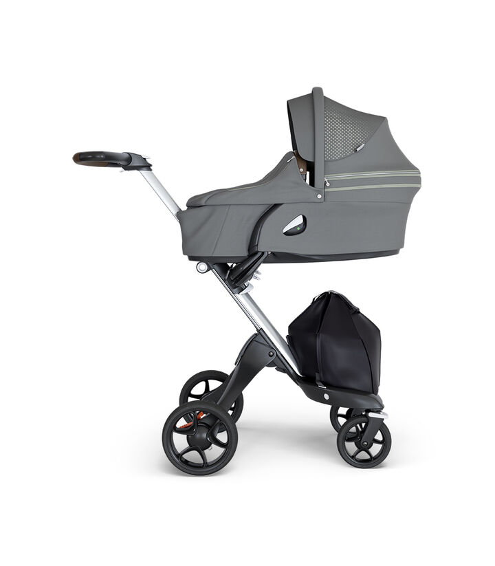 Stokke® Xplory® wtih Silver Chassis and Leatherette Brown handle. Stokke® Stroller Carry Cot Athleisure Green. view 1