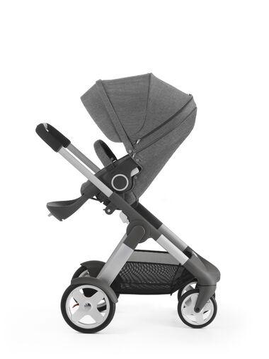 Stokke® Crusi™ with Stokke® Stroller Seat, Black Melange.