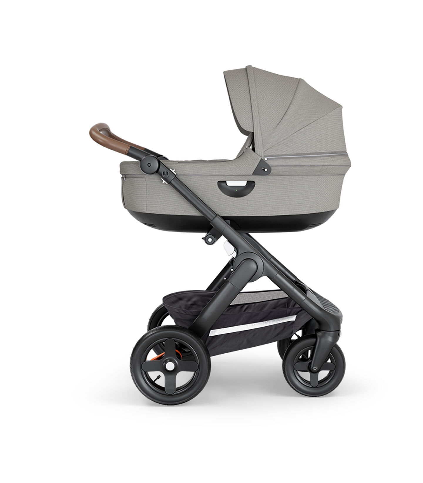 Stokke® Trailz™ with Black Chassis, Brown Leatherette and Terrain Wheels. Stokke® Stroller Carry Cot, Brush Grey.