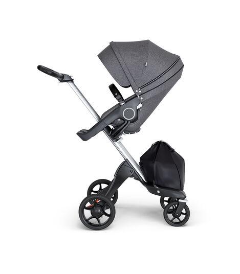 Stokke® Xplory® wtih Silver Chassis and Leatherette Black handle. Stokke® Stroller Seat Black Melange. view 3