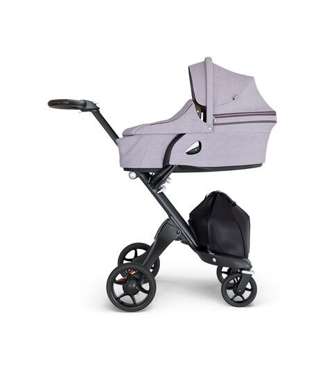 Stokke® Xplory® wtih Black Chassis and Leatherette Brown handle. Stokke® Stroller Carry Cot Brushed Lilac.