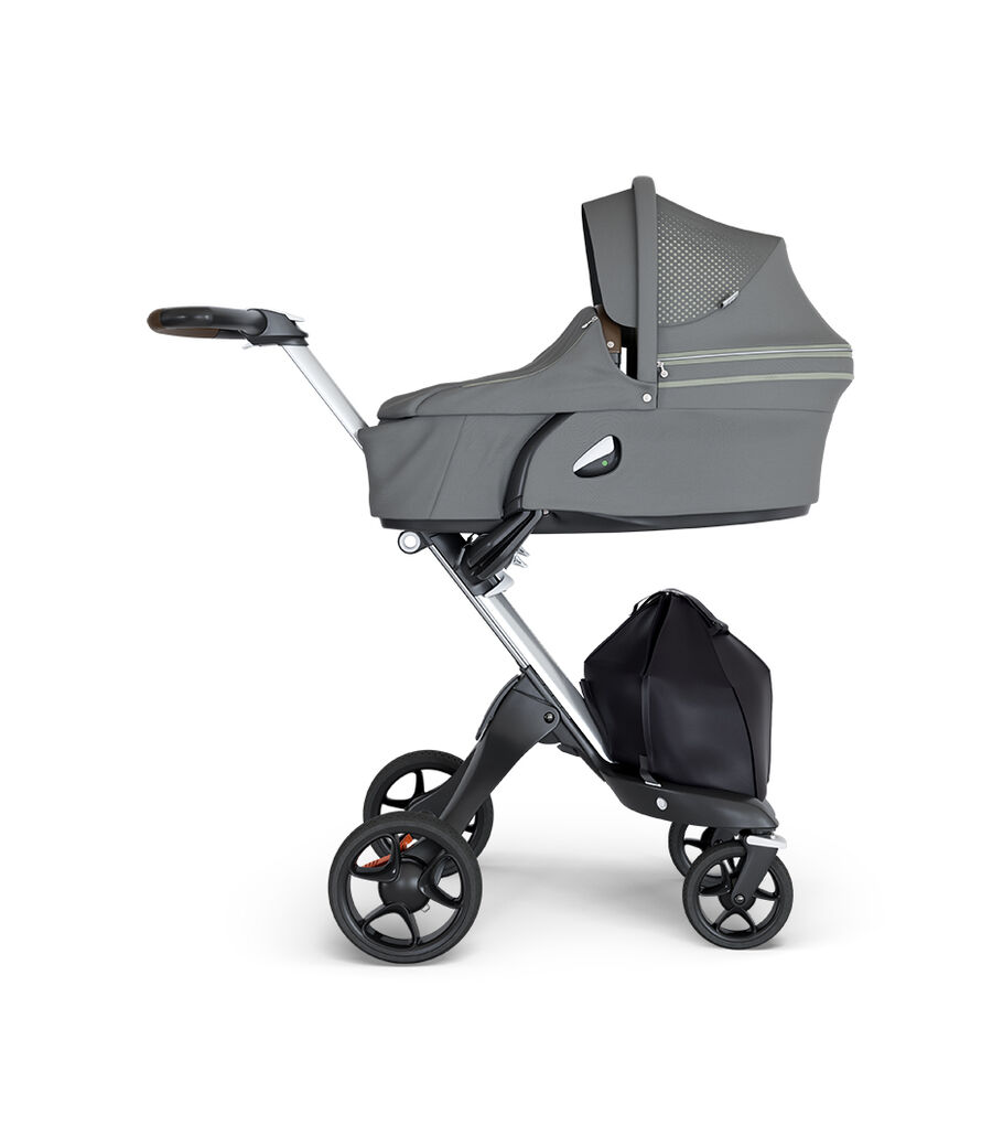 Stokke® Xplory® wtih Silver Chassis and Leatherette Brown handle. Stokke® Stroller Carry Cot Athleisure Green. view 3