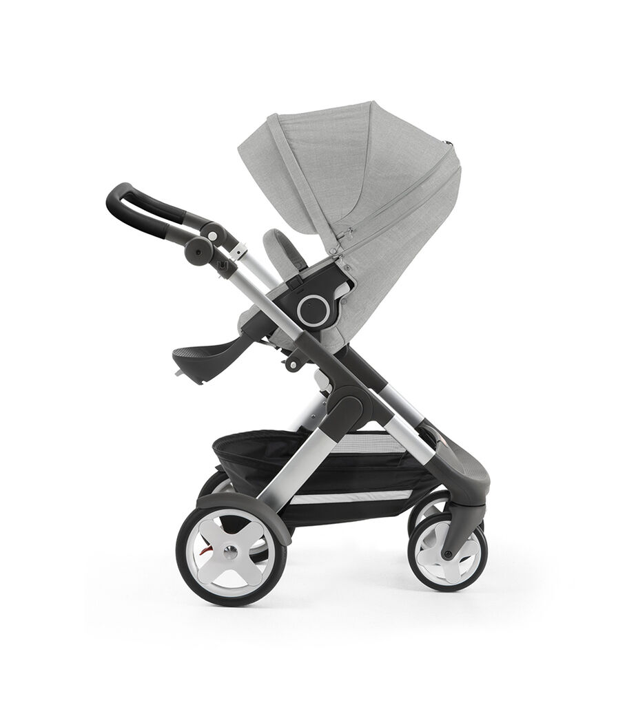 Stokke® Trailz™ with silver chassis and Stokke® Stroller Seat, Grey Melange. Classic Wheels.