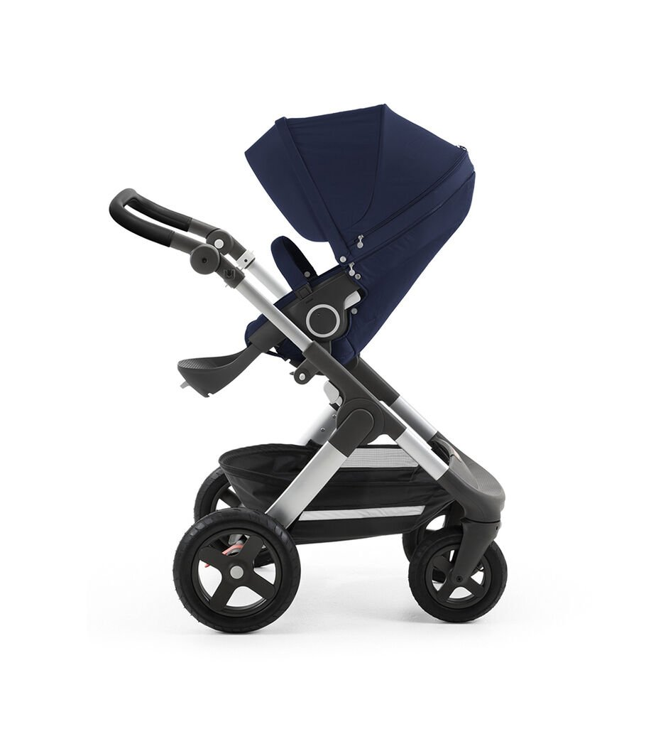Stokke® Trailz™ with silver chassis and Stokke® Stroller Seat, Deep Blue. Leatherette Handle. Terrain Wheels.