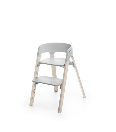Stokke® Steps™ Whitewash with Light Grey seat.