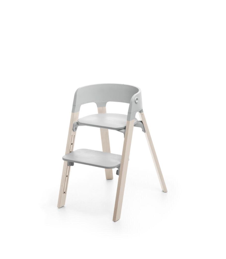Stokke® Steps™ Whitewash with Light Grey seat.