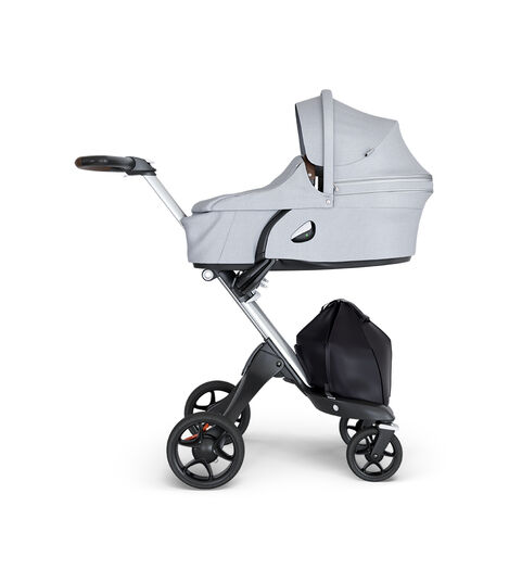 Stokke® Xplory® wtih Silver Chassis and Leatherette Brown handle. Stokke® Stroller Carry Cot Grey Melange. view 2