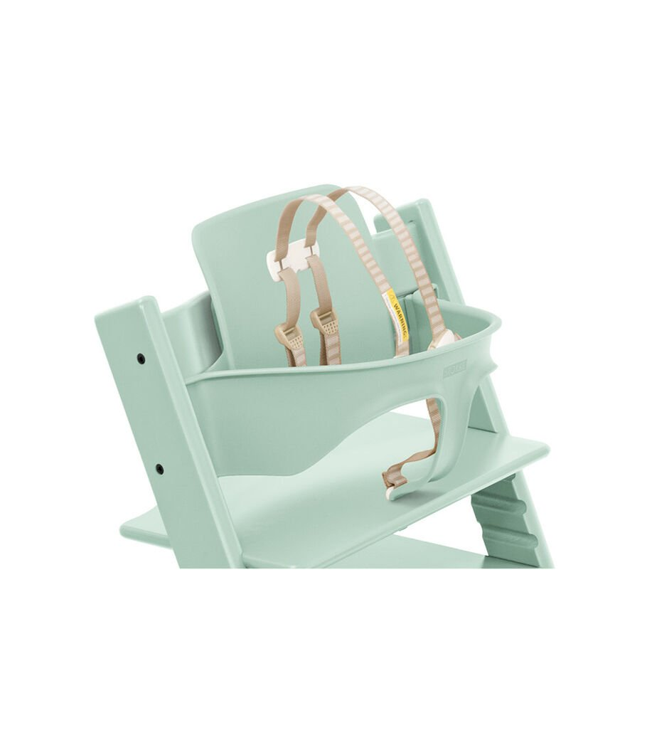 Tripp Trapp® Chair Soft Mint with Baby Set. Close-up. US with Harness.