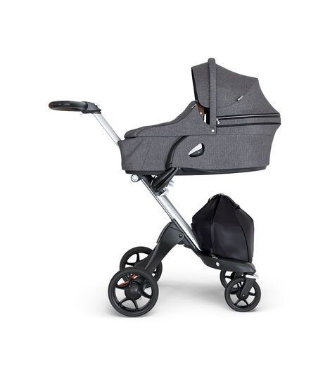 Stokke® Xplory® wtih Silver Chassis and Leatherette Brown handle. Stokke® Stroller Carry Cot Black Melange. view 2
