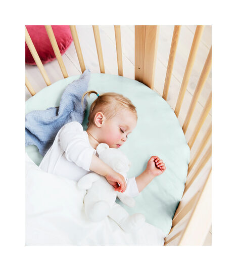 Stokke® Sleepi™ Bed, Natural with Fitted Sheet Powder Blue. view 2
