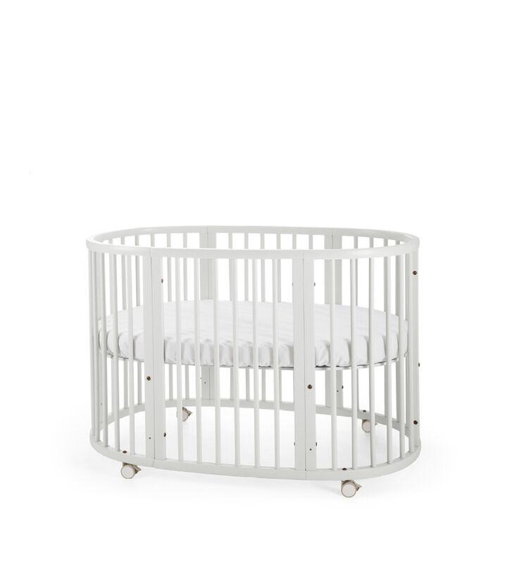 Stokke® Sleepi™ Bed. White. Mattress high. view 1