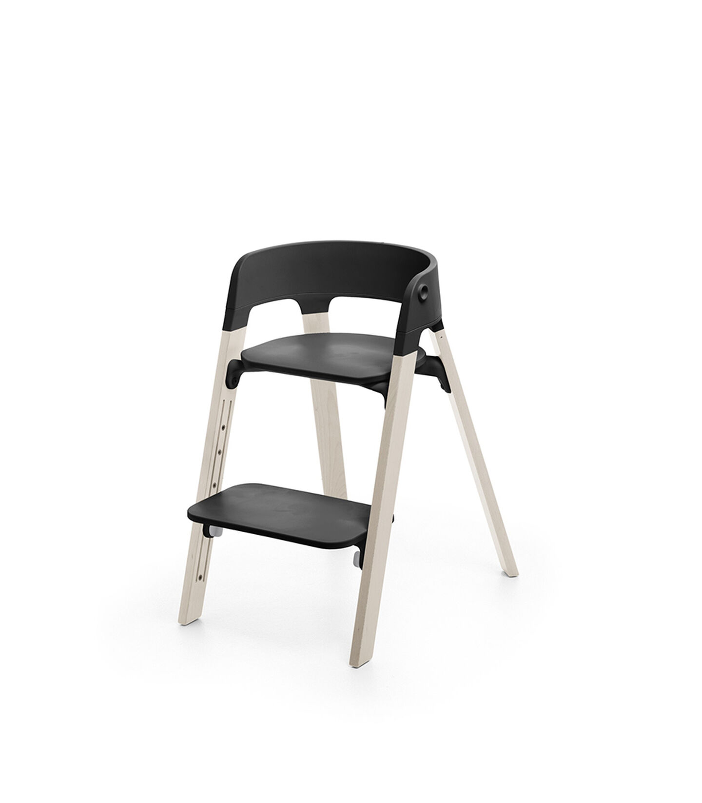 Stokke® Steps™ Whitewash with Black seat and footrest in low position.