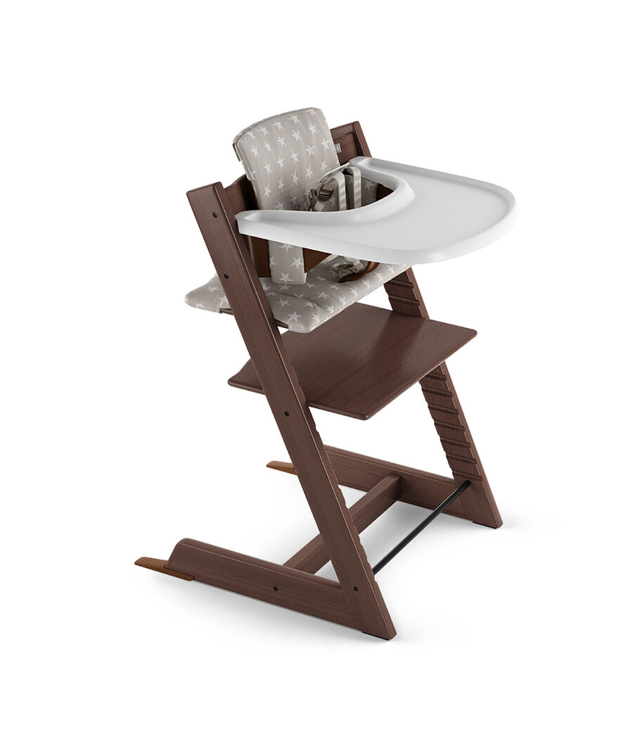 Tripp Trapp® Walnut Brown with Baby Set, Stokke® Tray White and Classic Cushion Grey Star. US version.