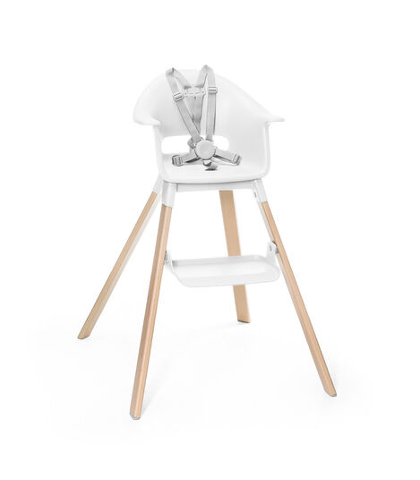 Stokke® Clikk™ High Chair. Natural Beech wood and White plastic parts. Stokke® Harness attached. Footrest high.