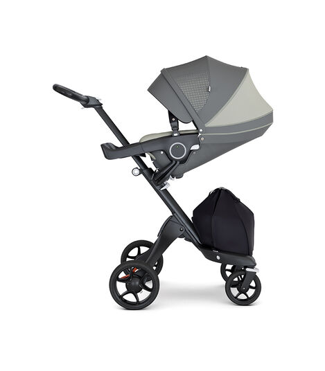 Stokke® Xplory® wtih Black Chassis and Leatherette Black handle. Stokke® Stroller Seat Athleisure Green extended canopy.