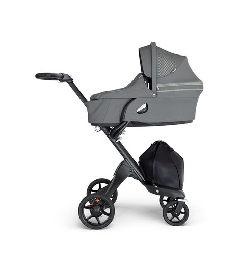 Stokke® Xplory® wtih Black Chassis and Leatherette Black handle. Stokke® Stroller Carry Cot Athleisure Green.