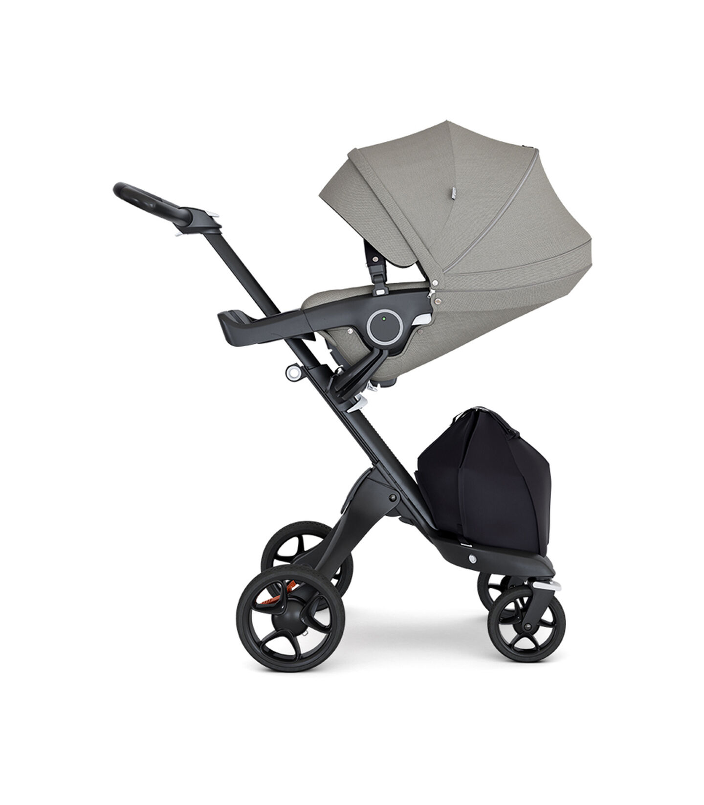 Stokke® Xplory® with Black Chassis and Leatherette Black handle. Stokke® Stroller Seat Brushed Grey with extended canopy.