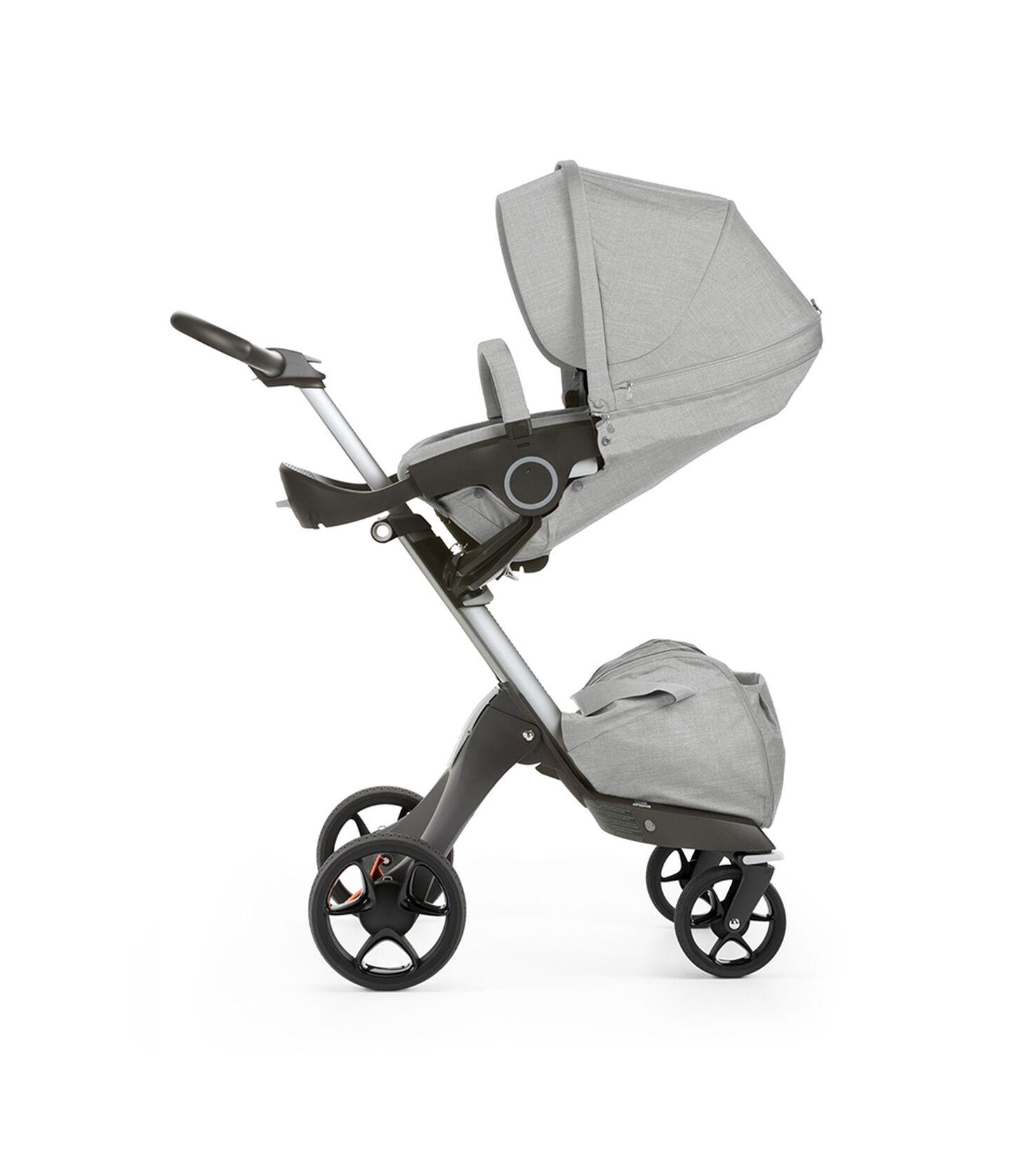 Stokke® Xplory® with Stokke® Stroller Seat, parent facing, sleep position. Grey Melange. New wheels 2016.