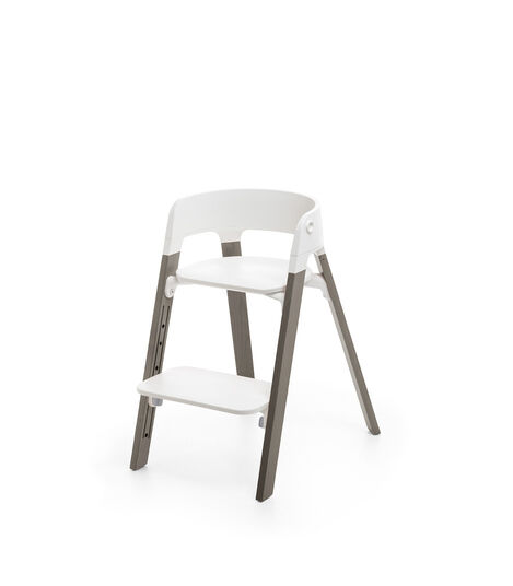 Stokke® Steps™ Hazy Grey  with white seat and footrest in low position.