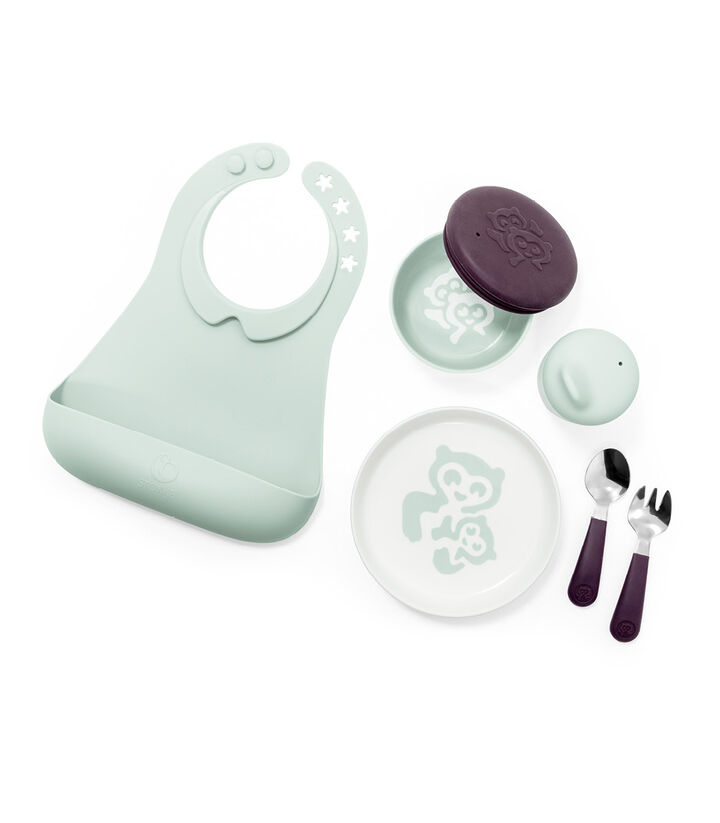 Stokke™ Munch Complete. Tableware collection. Includes: Plate with cutlery, bowl with lid, cup with lid and a soft silicone bib. view 1
