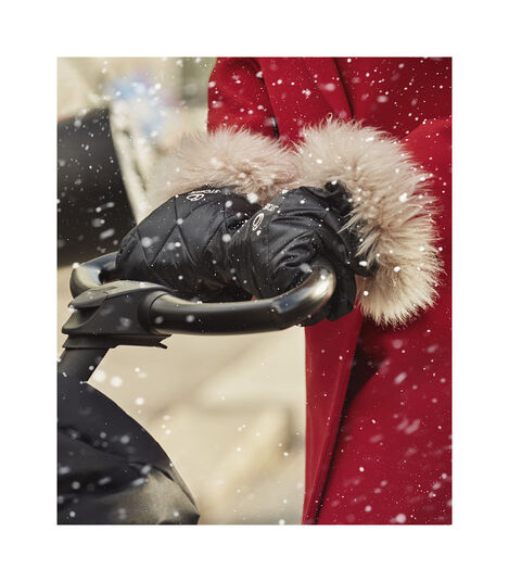 Stokke® Xplory® X Winter Kit Black in use on Seat, Rich Black. Foot Muff, Black. view 3