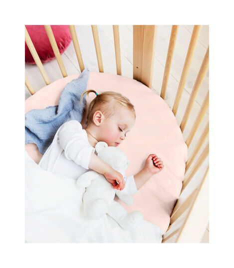 Stokke® Sleepi™ Bed, Natural with Fitted Sheet Peachy Pink.
