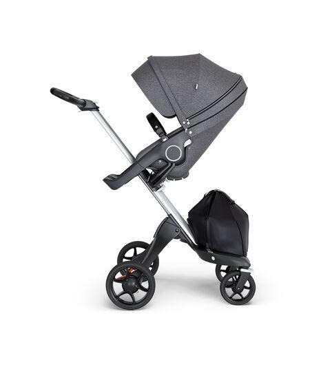 Stokke® Xplory® wtih Silver Chassis and Leatherette Black handle. Stokke® Stroller Seat Black Melange.