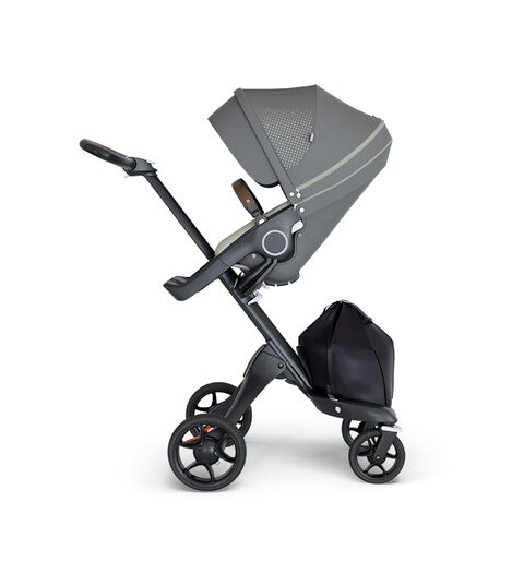Stokke® Xplory® wtih Black Chassis and Leatherette Brown handle. Stokke® Stroller Seat Athleisure Green. view 3