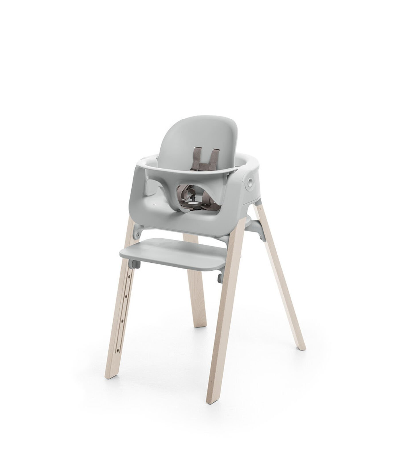 Stokke® Steps™ Whitewash chair with Baby Set Light Grey.