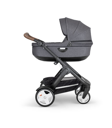 Stokke® Trailz™ with Black Chassis, Brown Leatherette and Classic Wheels. Stokke® Stroller Carry Cot, Black Melange. view 2