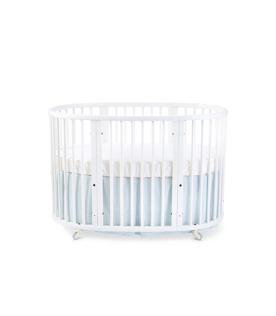 Stokke® Sleepi™ Bed, White. Bed Skirt Mist. US only.