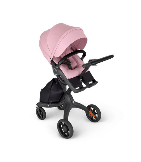 Stokke® Xplory® with Black Chassis and Leatherette Black handle. Stokke® Stroller Seat Lotus Pink in angled view. view 4