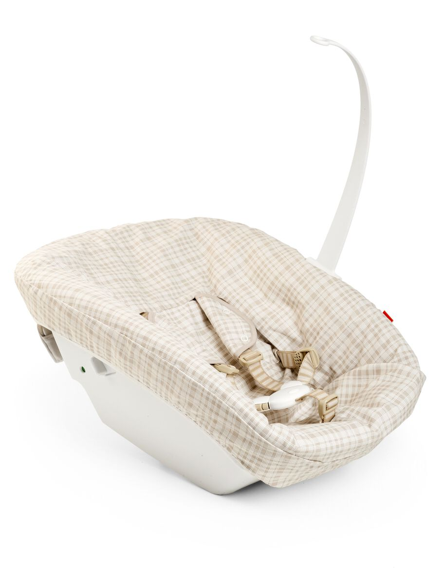 Tripp Trapp® Newborn Set with Beige Check textile.