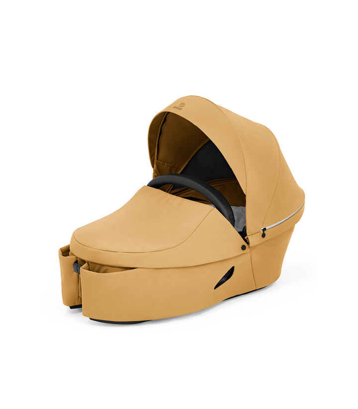 Stokke® Xplory® X Golden Yellow Carry Cot. view 1