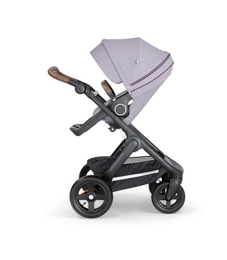 Stokke® Trailz™ with Black Chassis, Brown Leatherette and Terrain Wheels. Stokke® Stroller Seat, Brushed Lilac.