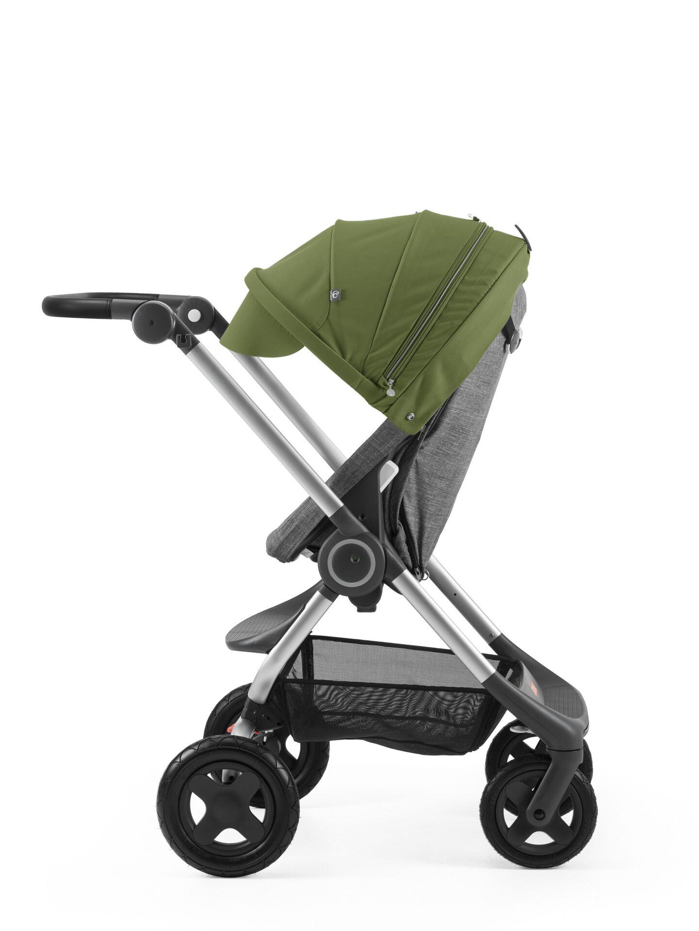 Stokke® Scoot™ Black Melange with Green Canopy. Parent facing, active position.