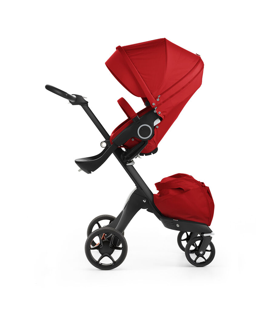 Stokke® Xplory® with Black chassis and Stokke® Stroller Seat, Red. New wheels 2016.