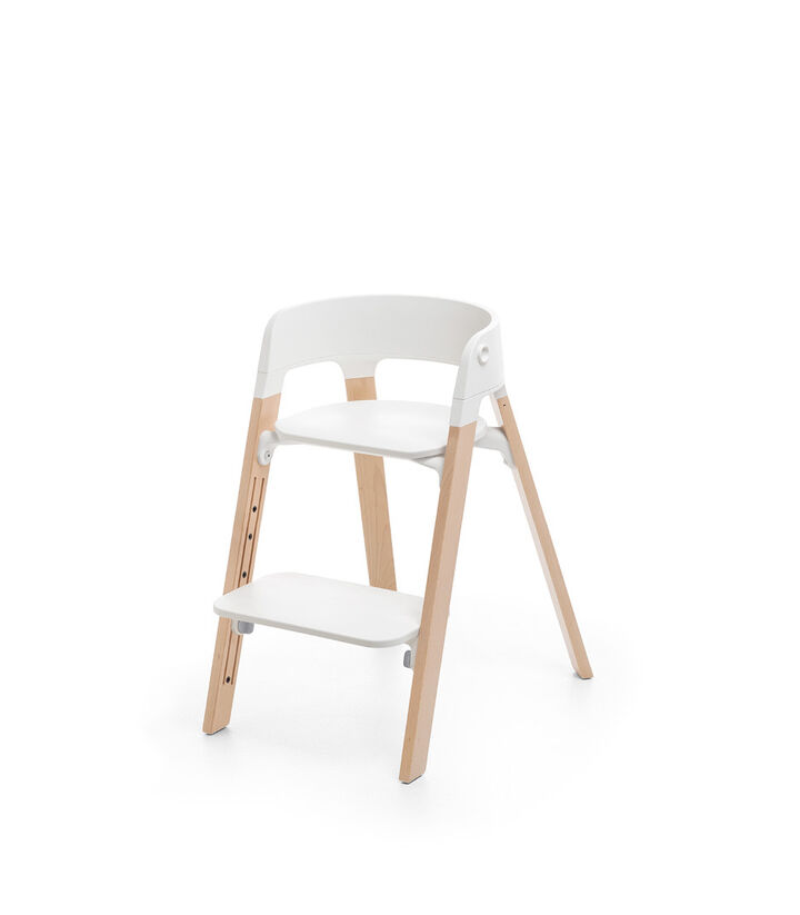 Stokke® Steps™ Chair, Beech Natural with White Seat. Footrest low.