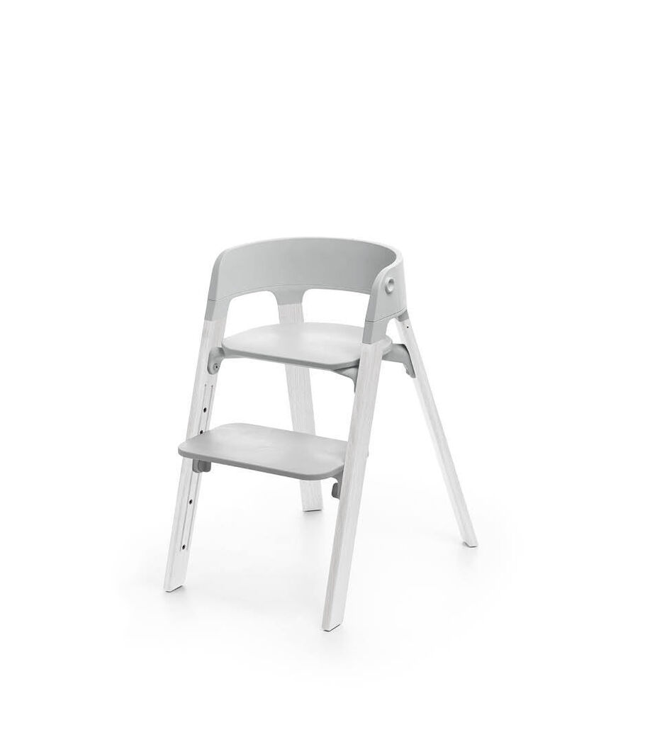 Stokke® Steps™ Oak White with Light Grey seat.