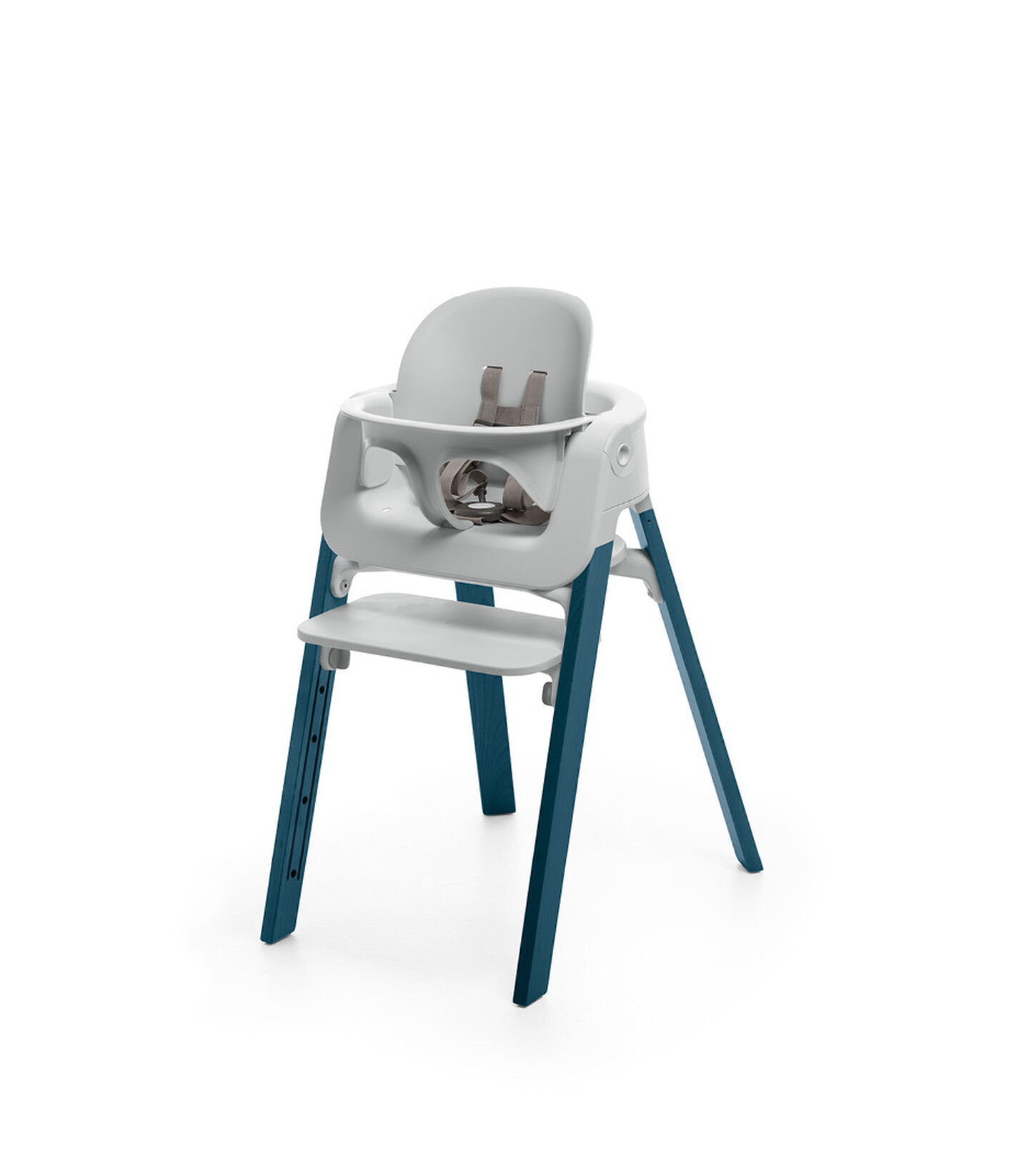 Stokke® Steps™ Midnight Blue chair with Baby Set Light Grey.