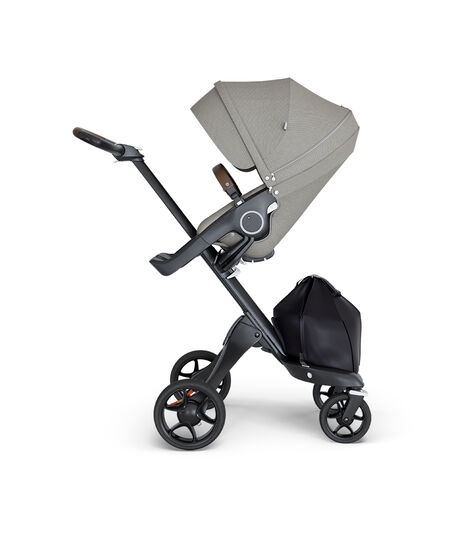Stokke® Xplory® wtih Black Chassis and Leatherette Brown handle. Stokke® Stroller Seat Seat Brushed Grey. view 3