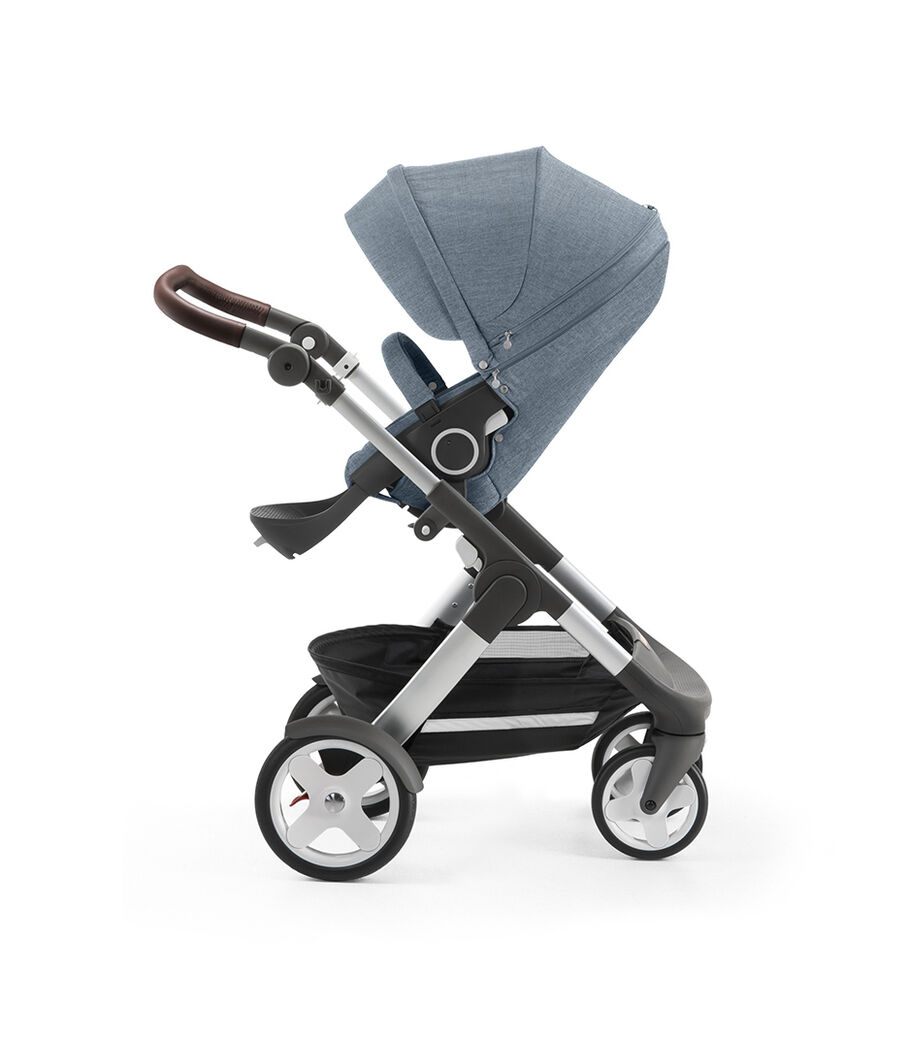 Stokke® Trailz™ with silver chassis and Stokke® Stroller Seat, Urban Blue. Classic Wheels.