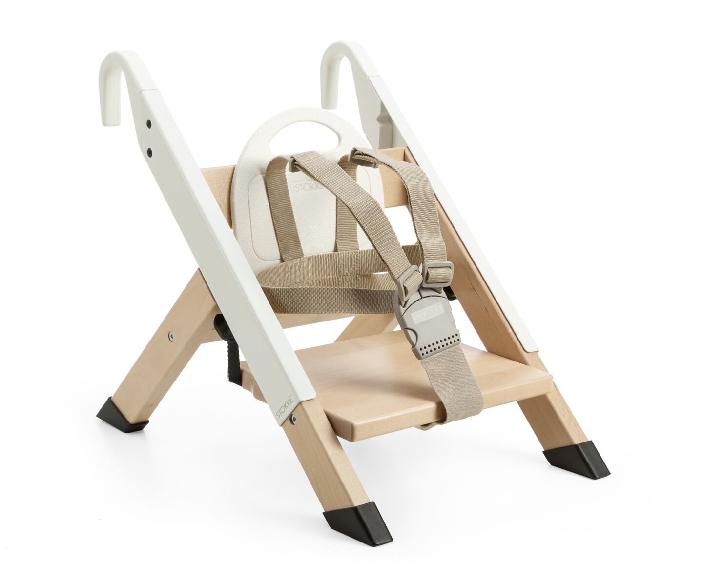 Portable child seat. White. Accessorised with legs for placing on the floor