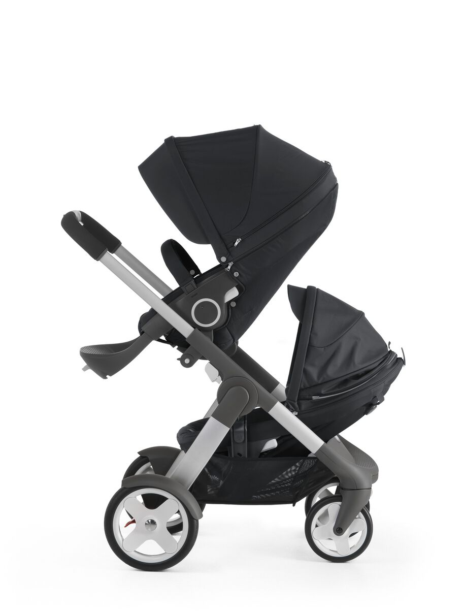 Stokke® Crusi™ with Stokke® Stroller Seat, Black and Sibling Seat.