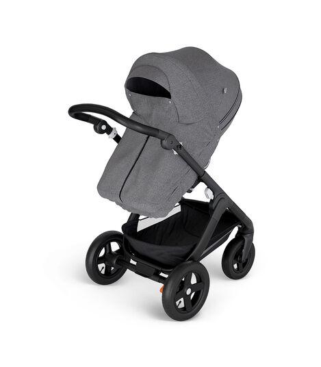 Stokke® Trailz™ with Black Chassis and Stokke® Stroller Seat Black Melange. Stokke® Stroller Storm Cover, Black Melange.